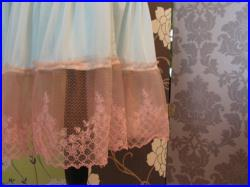0411 Woman's green skirt with pink lace.