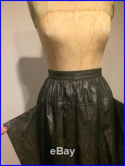 Atomic Silver and Black, Metallic Swing Skirt,with Bat Wing Panels, 26 inch waist, Perfect Condition,made in West Germany,36 inches long