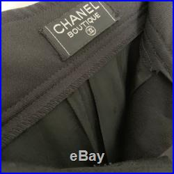 Authentic Chanel black wool skirt mermaide style gold buttons CC logo silk lining
