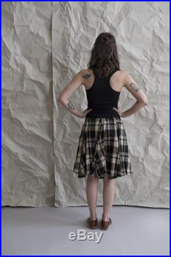 Camel plaid circle skirt. Two generous side pockets and a tall stretchy waistband for function and comfort. Fit and flare flowy skirt.
