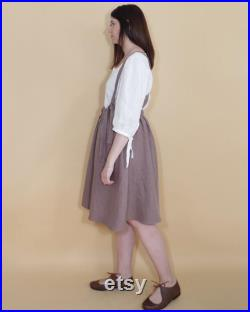 Dungaree buttoned skirt with pockets in organic dark mauve linen. Custom made upon request