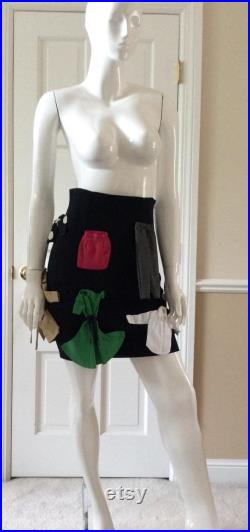 Moschino Couture 1989 vintage, museum quality unworn skirt, size 8, with miniature copies of iconic Moschino garments attached.