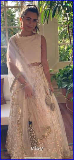 Off white thread embroidered wedding lehenga with silk blouse and dupatta