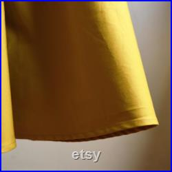 SUNFLOWER, curled, in pure solid color cotton. It will go elegant, going elegant, going in cotton, maxi going, going round