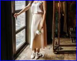 Silk skirt is as elementh vintage clothing and lounge wear. Midi satin skirt is ideal as gift for her or as detail retro style.