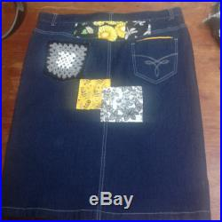 Upcycled Knee Length Denim Skirt in shades of Black, White, grey and yellow.